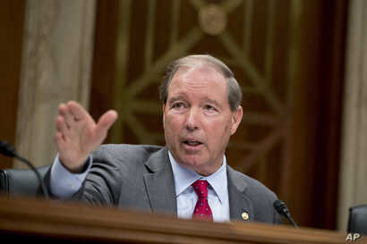 Ranking Member Sen. Tom Udall, D-New Mexico, questions EPA Administrator Scott Pruitt as he testifies before a Senate Appropriations subcommittee on Capitol Hill in Washington, May 16, 2018.
