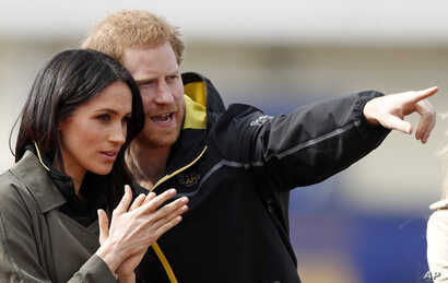 FILE - Britain's Prince Harry and his fiancee Meghan Markle attend the UK team trials for the Invictus Games Sydney 2018 at the University of Bath in Bath, England, April 6, 2018.