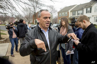 Jamal Khweis who identified himself as the father of Mohamad Jamal Khweis, a member of the Islamic State group who gave himself up to Iraqi Kurdish forces in northern Iraq on Monday, outside his home in Alexandria, Va., March 14, 2016.