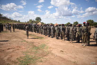 South Sudanese government soldiers stand at attention at Jebel Makor, 45 minutes outside of South Sudan's capital Juba, April 14, 2016. The soldiers were brought here as part of a process to reduce the number of troops in the city before the arrival ...