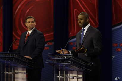 Republican gubernatorial candidate Ron DeSantis, left and Democratic gubernatorial candidate Andrew Gillum are shown during a debate, Oct. 21, 2018, in Tampa, Florida.