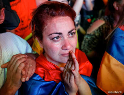 A supporter of Armenian opposition leader Nikol Pashinyan reacts, after his bid to be interim prime minister was blocked by the parliament, during a rally in central Yerevan, Armenia, May 1, 2018.