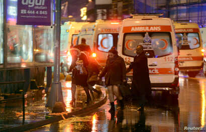 People run away from a nightclub where a gun attack took place during a New Year's Eve party in Istanbul, Turkey, Jan. 1, 2017.