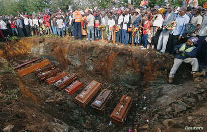 Coffins are seen arranged inside a mass grave during the burial of people killed when a dam burst its walls, overrunning nearby homes, in Solai town near Nakuru, Kenya, May 16, 2018.