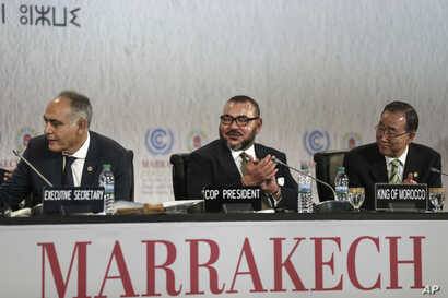From left, Morocco's Foreign Minister Salaheddine Mezouar, Morocco's King Mohammed VI and U.N. Secretary-General Ban Ki-moon attend the opening session of the U.N. climate conference in Marrakech, Morocco, Nov. 15, 2016.