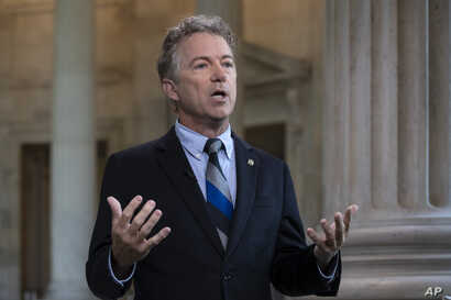 Sen. Rand Paul, R-Ky., speaks during a television interview on Capitol Hill in Washington, July 17, 2018, as he defends President Donald Trump and his Helsinki news conference with Russian President Vladimir Putin.