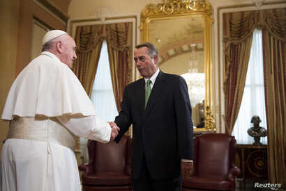 Speaker of the House John Boehner, R-Ohio (R) meets Pope Francis in the U.S. Capitol building as the Pope arrives to deliver his speech to a joint meeting of Congress in Washington DC, Sept. 24, 2015.