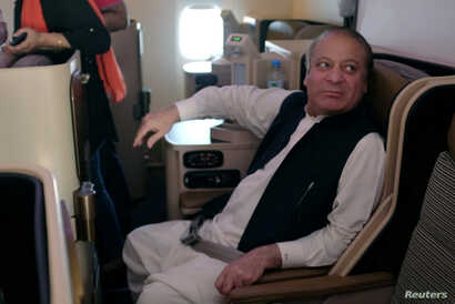 Ousted Pakistani Prime Minister Nawaz Sharif sits on a plane after landing at the Allama Iqbal International Airport in Lahore, Pakistan, July 13, 2018.
