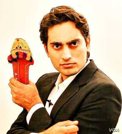 "Danish Ali with a prop used in his video ""Super Chittar"""