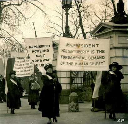 This is a circa 1918 photo of women demonstrating at the White House demanding voting rights.