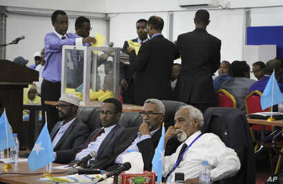 Votes are counted in the first round of the presidential election in Mogadishu, Somalia, Feb. 8, 2017.