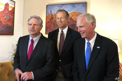 U.S. Sen. John Hoeven, R-N.D., left, Sen. John Thune, R-S.D., center, and Sen. Jerry Moran, R-Kan., chairman of the Subcommittee on Consumer Protection, Product Safety, Insurance, and Data Security, speak to the Associated Press in the U.S. Embassy i...