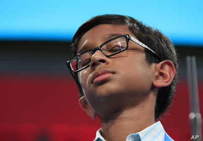 Rohan Rajeev, 14, from Edmond, Okla., reacts after misspelling his word and eventually losing to Ananya Vinay from Fresno, Calif., during the finals of the 90th Scripps National Spelling Bee, in Oxon Hill, Md., June 1, 2017.