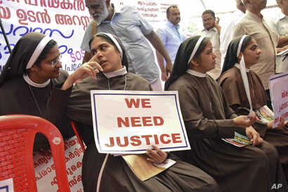 Catholic nuns hold placards demanding the arrest of a bishop who one nun has accused of rape, during a public protest in Kochi, Kerala, India, Sept. 12, 2018.