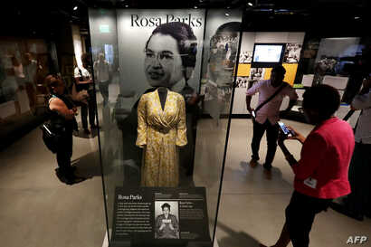 Civil Rights pioneer Rosa Parks' dress is on display in the concourse galleries at the Smithsonian's National Museum of African American History and Culture on the National Mall Sept. 14, 2016 in Washington, DC.