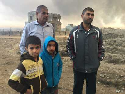 """4283: """"Even our spit is dry and black,"""" says one father who's family did not leave the area for Islamic State or the fires.  """"Life here is finished,"""" he added, in Qayyarah, Iraq,  Nov. 5, 2016."""