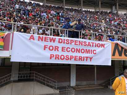 Supporters of President Emmerson Mnangagwa display a banner in Harare, April 18, 2018, showing what the new government is promising Zimbabweans.