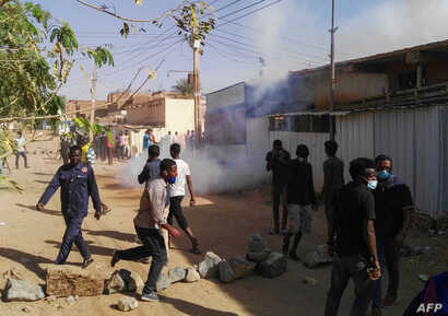 FILE - Sudanese protesters demonstrate against their government in the capital Khartoum's district of Burri, Feb. 24, 2019.