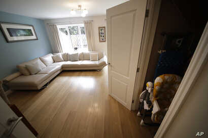 A cupboard under the stairs, which was replaced by one filmed in a studio, is shown next to the living room in the house for sale that starred onscreen as Harry Potter's childhood home in the town of Bracknell, England, west of London, Sept. 20, 2016...