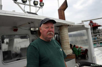 Lobsterman Perley Frazier poses on his boat,Jericho's Way, in Stonington, Maine, July 7, 2017.
