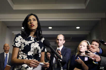 Huma Abedin, a longtime aide to Hillary Rodham Clinton, speaks to the media after testifying at a closed-door hearing of the House Benghazi Committee, on Capitol Hill, Oct. 16, 2015 in Washington.