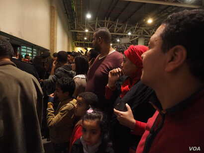 Families and relatives of passengers on the hijacked flight waiting at Cairo airport, Tuesday, March 28, 2016. (H. Elrasam/VOA)