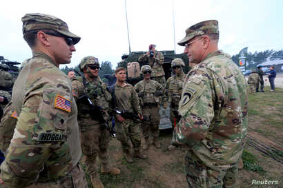 U.S. Army Europe commander Ben Hodges speaks to soldiers during the final day of NATO Saber Strike exercises in Orzysz, Poland, June 16, 2017.
