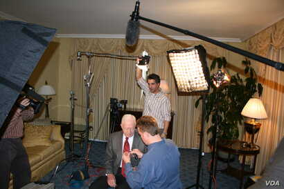 "Preparing President Carter for an interview in 2006 in Chicago during the book tour for ""Palestine: Peace Not Apartheid."""