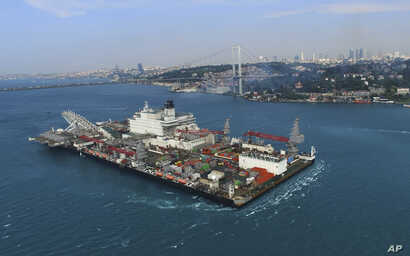 The 'Pioneering Spirit' vessel crosses the Bosphorus Strait in Istanbul, May 31, 2017. The strait was closed to traffic due to the transiting of the vessel, which will carry out the construction of a Turkish natural gas offshore pipeline.
