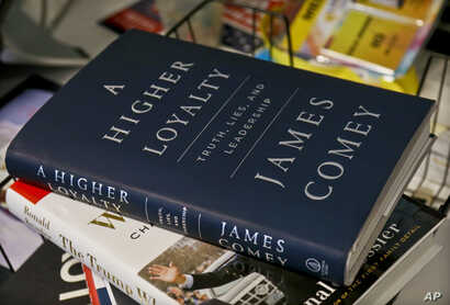 "A copy of former FBI Director James Comey's new book, ""A Higher Loyalty: Truth, Lies and Leadership,"" is on display, Apr. 13, 2018, in New York."