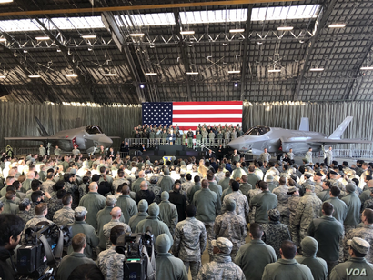 U.S. Vice President Mike Pence speaks to the troops gathered in a hangar at Yokota Air Base Japan, Feb. 8, 2018. A pair of U.S. Air Force F-35 jets flank the vice president.