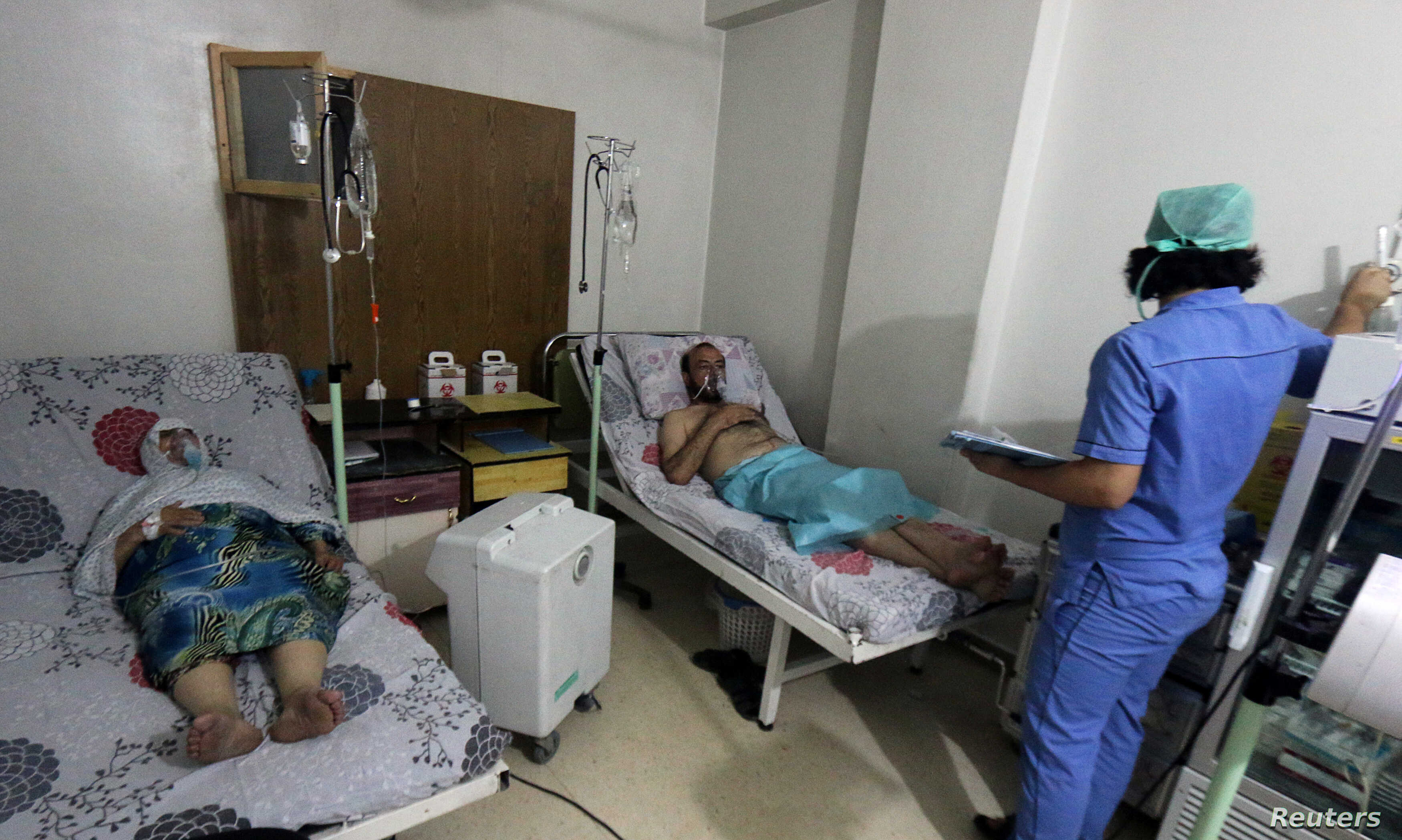 Civilians breathe through an oxygen mask at al-Quds hospital, after a hospital and a civil defence group said a gas, what they believed to be chlorine, was dropped alongside barrel bombs on a neighbourhood of the Syrian city of Aleppo, Syria, early A...