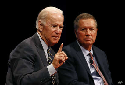 Former vice president Joe Biden, left, and Ohio Governor John Kasich participate in a discussion on bridging political and partisan divides, at the University of Delaware in Newark, Delaware, Oct. 17, 2017.