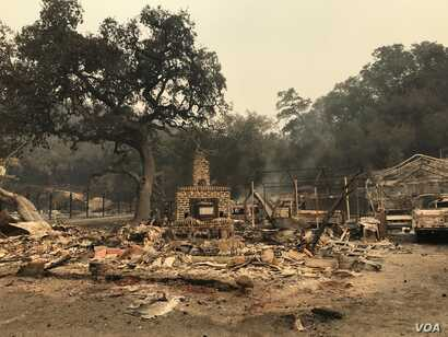 Fires continued to burn Oct. 11, 2017 in Sonoma County, Calif. The fires destroyed hundreds of buildings across several counties, and authorities evacuated more people.