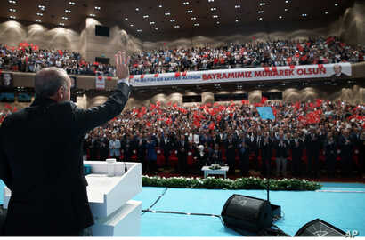 Turkish President Recep Tayyip Erdogan salutes people gathered to celebrate the Muslim holiday of Eid al-Adha in Istanbul, Sept. 13, 2016.