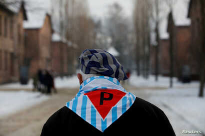 A survivor is seen at the former Nazi German concentration and extermination camp Auschwitz, as he attends ceremonies marking the 74th anniversary of the liberation of the camp and International Holocaust Victims Remembrance Day, in Oswiecim, Poland,...