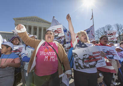 FILE - Immigration activists demonstrate at the Supreme Court in Washington in support of President Barack Obama's executive order to grant relief from deportation in order to keep immigrant families together, March 18, 2016.