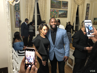 NFL star, Haitian-American Pierre Garcon poses for a photo with Miss Black America, Brittany Lewis at the Haitian Embassy's fashion event in Washington, D.C., Feb 23, 2018. (Photo: S. Lemaire / VOA)