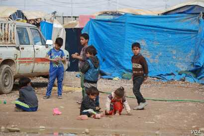 Extreme poverty, lack of services and backlash against relatives of IS fighters has driven up the population of many displacement camps in Iraq in recent weeks, pictured on Feb. 28, 2018 in Haj Ali, Iraq.