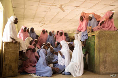 The students of the Dapchi girls school relax and hang out in their dorm room on a Saturday.