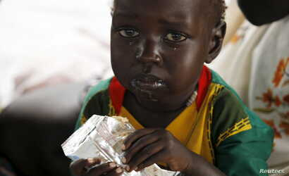 A refugee child from South Sudan feeds on food supplements at a health center at the Kule refugee camp in Ethiopia's Gambella region, April 1, 2015.