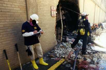 This undated photo provided by the FBI shows damage to the Pentagon caused during the 9/11 attacks. This was one of 27 photos that were posted to the FBI website in 2011 but disappeared recently because of a technical glitch.