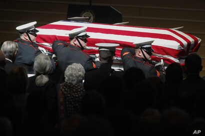 Marines carry John Glenn's casket at the end of his funeral at Ohio State University in Columbus, Dec. 17, 2016.