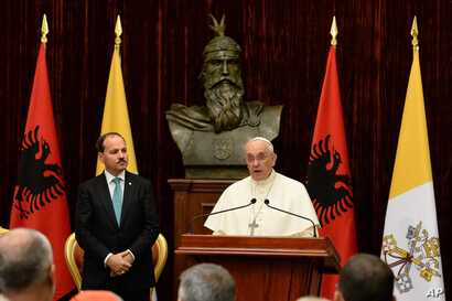 Albania PopePope Francis delivers his speech as Albania's President Bujar Nishani, left, watches in Tirana, Sept. 21, 2014.