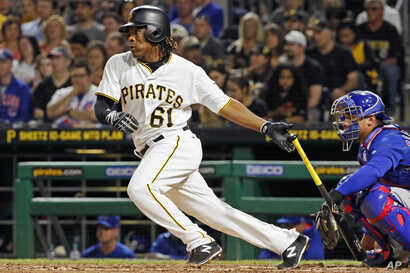 Pittsburgh Pirates' Gift Ngoepe, a native of South Africa, and the first baseball player from the continent of Africa to play in the Major Leagues, hits a single off Chicago Cubs starting pitcher Jon Lester in his first at-bat in the fourth inning of