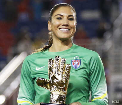 United States' goalkeeper Hope Solo (1) poses with the golden glove award after the SheBelieves Cup, March 9, 2016,  in Boca Raton, Florida.