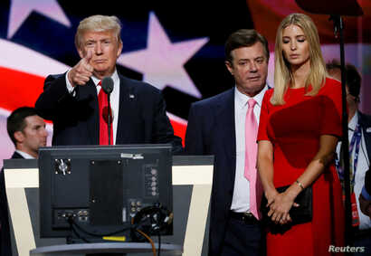 Republican presidential nominee Donald Trump gives a thumbs up as his campaign manager Paul Manafort (C) and daughter Ivanka (R) look on during Trump's walk through at the Republican National Convention in Cleveland, U.S., July 21, 2016.