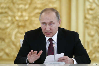 Russia's President Vladimir Putin delivers a speech during a session of the Council for Civil Society and Human Rights in Moscow, Thursday Dec. 8, 2016.