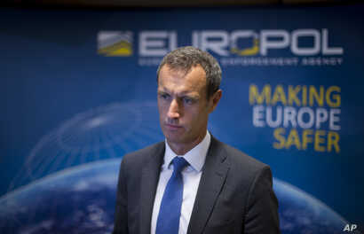 FILE -  The head of the European police agency Europol, Rob Wainwright answers questions at The Hague, Netherlands, Jan. 16, 2015. Dick Schoof, the Dutch counterterrorism coordinator, said Friday 60-80 Islamic State operatives are in Europe.
