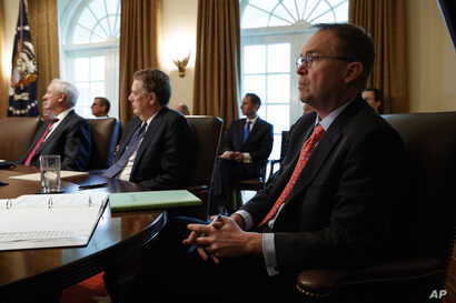 FILE - White House Chief of Staff Mick Mulvaney listens as President Donald Trump speaks during a cabinet meeting at the White House, Jan. 2, 2019, in Washington.
